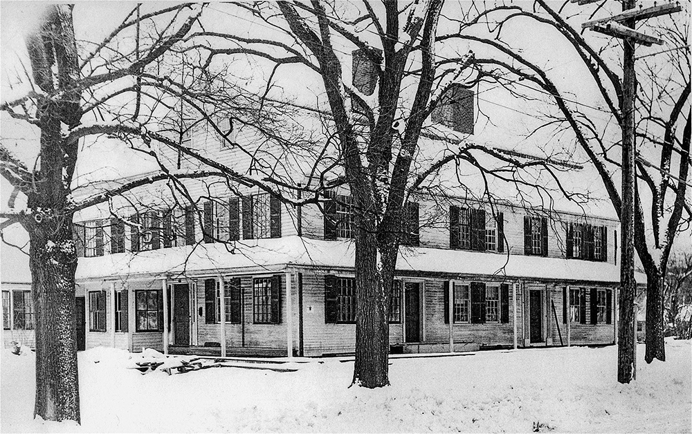 1952 photograph of the Josiah Smith Tavern in winter
