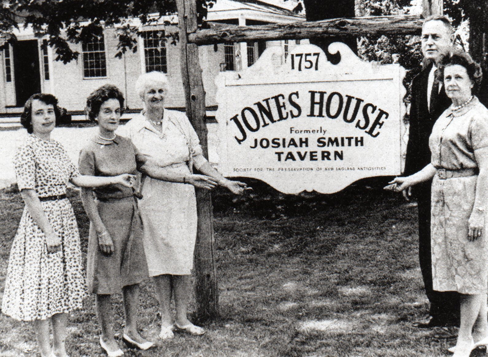 Founding members of Weston History Society standing by sign of Jones House (Josiah Smith Tavern)