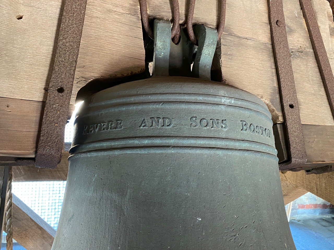 """closeup view of bell showing inscription """"Revere and Sons Boston"""""""